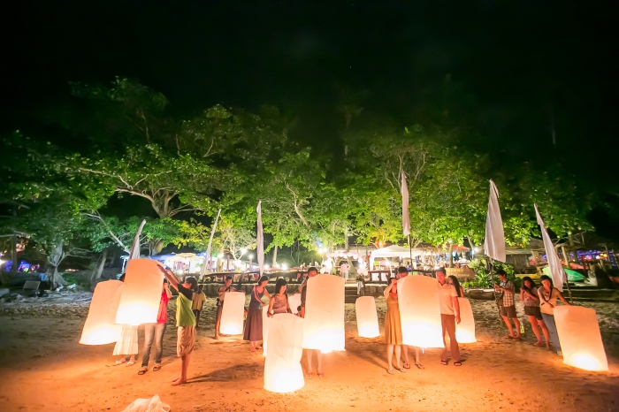 Setting off lanterns after everyone is half drunk during my wedding party last Dec (Photo by Garick Bay)