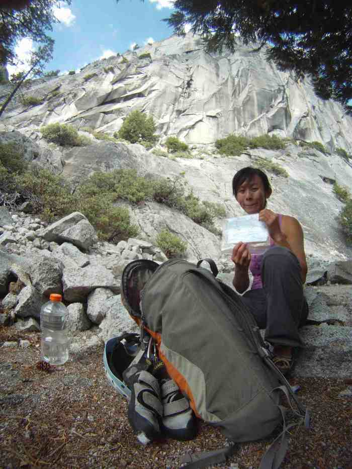 Kelly getting to our bivy spot.. Checking the topo with Liberty Cap behind her