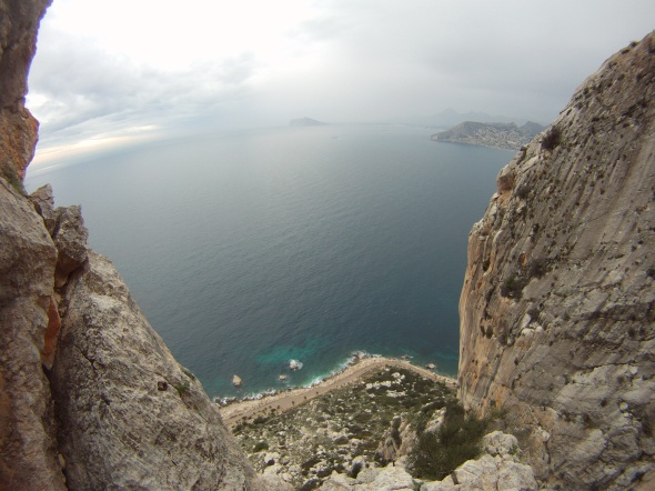 The view from pitch 4 of Coasta Blanca with the rain chasing us up the wall