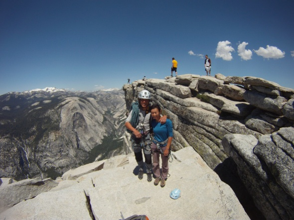 2009 photo of Kelly and I on Regular North West Route of Half Dome. Mount Watkins is the wall to the left of me with a depression in the middle.
