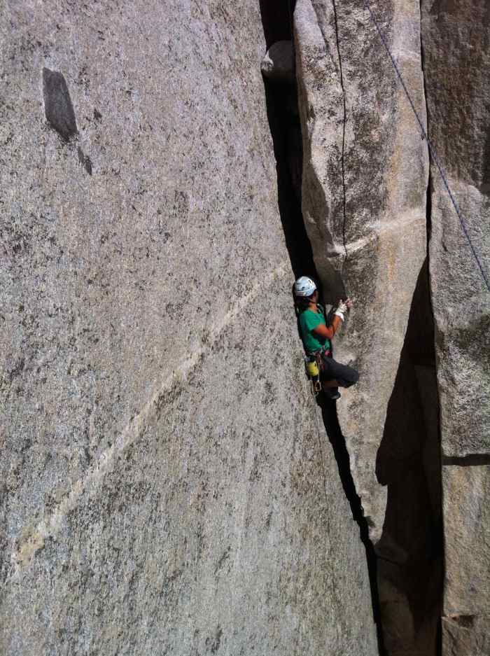 Kelly muscling some funky off width and squeeze variation on La Cosita left at the base of El Cap